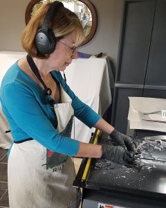 """I use a variety of methods to create art. The most recent one I have learned is called sgraffito, Italian for """"painting with glass."""" I use glass powder, which is like painting with colored air, and quite challenging.  I used this technique exclusively with """"Sierras"""" and to a lesser extent with """"Birds in Flight.""""  I use a many different types of glass and in many forms, which I cook in a kiln. This includes glass that reacts with other types and produce a variety of effects, some that be controlled and some that result in a surprise. For the jewelry I layer dichroic glass and sometimes use this is combination with powders, frit, murrini and transparent glass.  Fusing glass requires knowledge of the nature of glass itself and schedules for heating and annealing the glass. It's an art and science, and I am constantly experimenting and learning."""